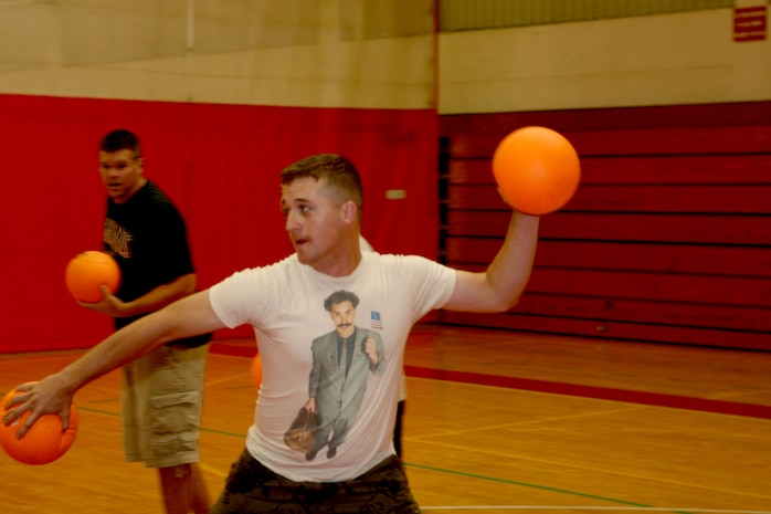 Chris Wliszczak, Marine Corps Air Facilities Renegades player,  rears back as he prepares to throw, during a 101 Days of Summer dodge-ball tournament at the Semper Fit Center Aug. 16.