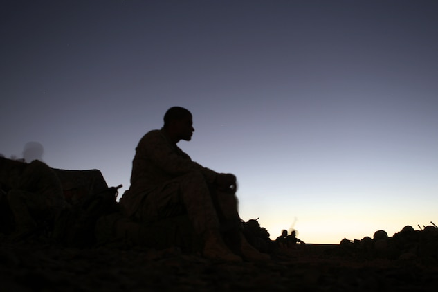 "A Marine with Fox Company, Battalion Landing Team 2/5, 15th Marine Expeditionary Unit, rests after a day of training during the bi-lateral training exercise ""Infinite Moonlight"" in the Jordanian desert.::r::::n::   Infinite Moonlight, a two-week exercise conducted by the U.S. military and the Jordanian Army, is designed to share tactical knowledge and build on the military ties between the United States and Jordan.::r::::n::   The Camp Pendleton, Calif. based 15th MEU is comprised of approximately 2,200 Marines and Sailors and is a forward deployed force of readiness capable of conducting numerous operations, such as Non-Combatant Evacuation Operations, Humanitarian Assistance Operations and a wide range of amphibious missions. ::r::::n::   The 15th MEU is currently conducting sustainment training in the desert of Jordan. (Official USMC photo by Cpl. Timothy T. Parish) (Released)::r::::n::"