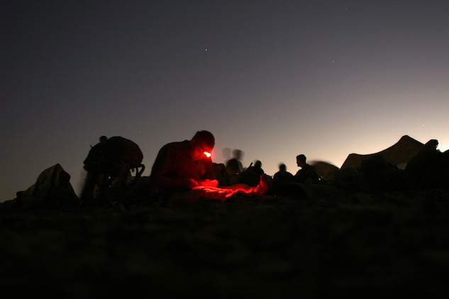 A Marine with Company F, Battalion Landing Team 2/5, 15th Marine Expeditionary Unit, rests after a day of training during the bi-lateral training exercise Infinite Moonlight in the Jordanian desert.