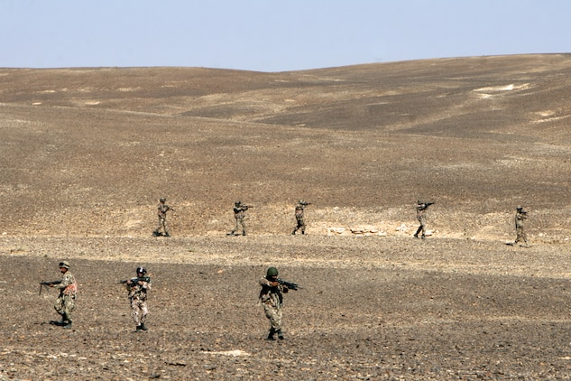 "Jordanian soldiers conduct a security patrol during the bi-lateral training exercise ""Infinite Moonlight"" in the Jordanian desert.::r::::n::   Infinite Moonlight, a two-week exercise conducted by the U.S. military and the Jordanian Army, is designed to share tactical knowledge and build on the military ties between the United States and Jordan.::r::::n::   The Camp Pendleton, Calif. based 15th MEU is comprised of approximately 2,200 Marines and Sailors and is a forward deployed force of readiness capable of conducting numerous operations, such as Non-Combatant Evacuation Operations, Humanitarian Assistance Operations and a wide range of amphibious missions. ::r::::n::   The 15th MEU is currently conducting sustainment training in the desert of Jordan. (Official USMC photo by Cpl. Timothy T. Parish) (Released)::r::::n::"