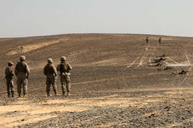 "Marines with Fox Company, Battalion Landing Team 2/5, 15th Marine Expeditionary Unit, watch as Jordanian soldiers conduct a security patrol during the bi-lateral training exercise ""Infinite Moonlight"" in the Jordanian desert.::r::::n::   Infinite Moonlight, a two-week exercise conducted by the U.S. military and the Jordanian Army, is designed to share tactical knowledge and build on the military ties between the United States and Jordan.::r::::n::   The Camp Pendleton, Calif. based 15th MEU is comprised of approximately 2,200 Marines and Sailors and is a forward deployed force of readiness capable of conducting numerous operations, such as Non-Combatant Evacuation Operations, Humanitarian Assistance Operations and a wide range of amphibious missions. ::r::::n::   The 15th MEU is currently conducting sustainment training in the desert of Jordan. (Official USMC photo by Cpl. Timothy T. Parish) (Released)::r::::n::"
