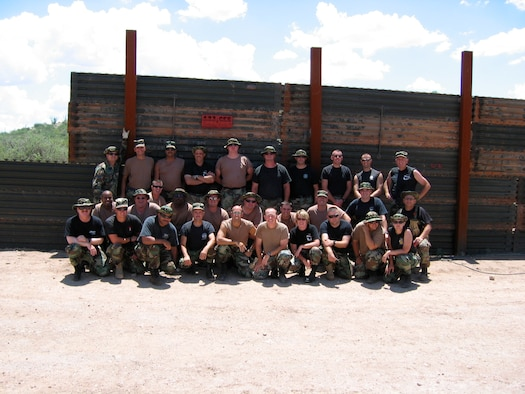 Members of the 123rd Civil Engineering Squadron in front of the border.