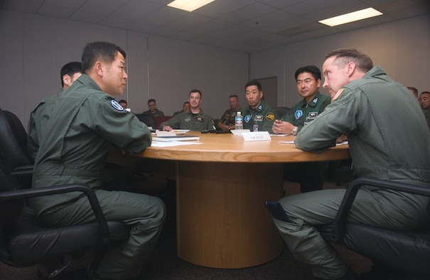 Col. Mutsumi Fukushima (left), commander of the Japanese Air Self-Defense