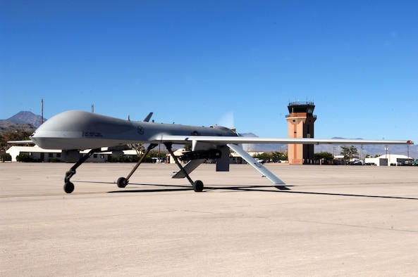 An MQ-1 Predator unmanned aircraft system taxies down a runway Aug. 13 at Creech Air Force Base, Nev. The Predator recently passed 400,000 flight hours during missions over Iraq and Afghanistan. (U.S. Air Force photo/Senior Airman Larry E. Reid Jr.)