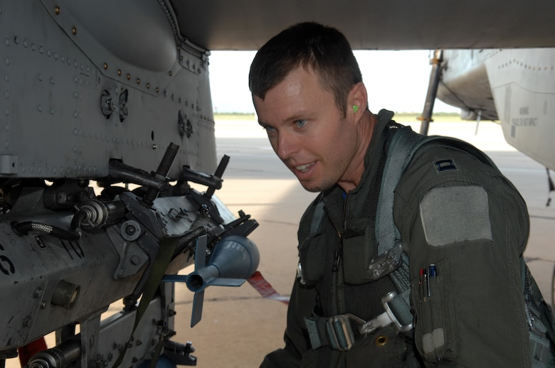 Captain Bryan Wojcik, 357th Fighter Squadron, looks at the bombs on the A-10C Thunderbolt II during his pre-flight tasks before his mission, here on Aug. 8, 2008.  Capt Wojcik is here to training at the 357th to learn the new C-model aircraft.  (US Air Force Photo By: Senior Airman Jacqueline Romero)