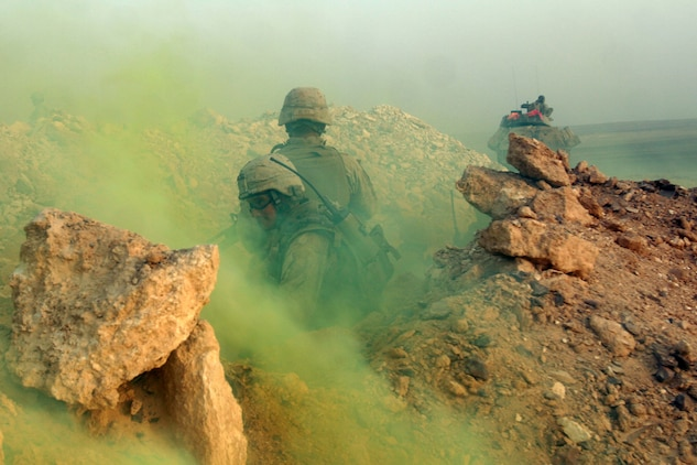 """Al QATRANAH, Jordan, (Aug. 19, 2008) -- Sgt. Alexander Hebert, a Scout Section Leader with the Light Armored Vehicle platoon, 15th Marine Expeditionary Unit, provides cover as a smoke grenade masks the teams retrograde to a LAV in Jordanian desert during """"Operation Infinite Moonlight."""" For the LAV platoon the purpose of the training was to refine basic infantry tactics such as trench assaults, weaponry skills, ambush training and a gunnery skills with the LAV's main cannon.  The Camp Pendleton, Calif., based  15th MEU  is comprised of approximately 2,200 Marines and Sailors and is a forward deployed force in readiness capable of conducting numerous operations, such as Non-Combatant Evacuation Operations, Humanitarian Assistance Operations and range of  amphibious missions. The MEU is currently deployed aboard USS Peleliu (LHA-5), USS Dubuque (LPD-8) and USS Pearl Harbor (LSD-52). (Official USMC photo by Cpl. Stephen Holt)(Released)::r::::n::"""