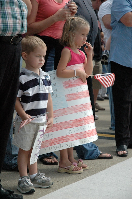 Children wait for the arrival of their loved one at the Kentucky Air National Guard Base on Sept. 9 as the wing's deployment to Bagram Airfield, Afghanistan, concludes.(Capt. Dale Greer/KyANG)