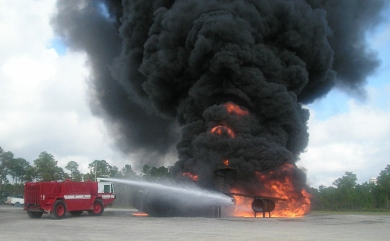 Firefighters extinguish a blaze on a simulated fighter aircraft at Tyndall Air Force Base, Fla. (Photo courtesy 123rd Civil Engineering Squadron)