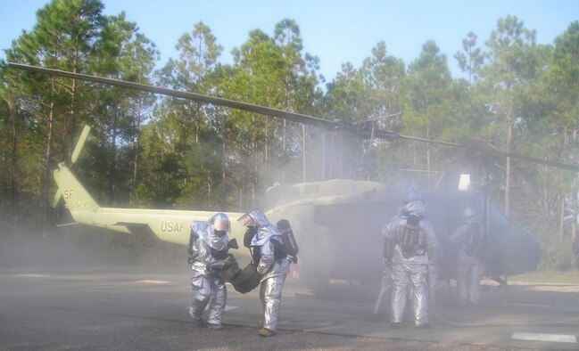Firefighters from the Kentucky Air Guard's 123rd Civil Engineering Squadron practice