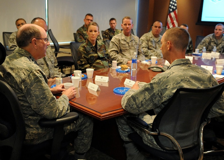 BUCKLEY AIR FORCE BASE, Colo. -- Gen. C. Robert Kehler, Air Force Space Command commander, visits with some of the base's enlisted professional performers and senior noncommissioned officers during a breakfast get-together to discuss enlisted leadership. General Kehler spent Aug. 19 and 20 on the base visiting work centers for the first time since taking command of AFSPC in October 2007. (U.S. Air Force photo by Senior Airman Steven Czyz)