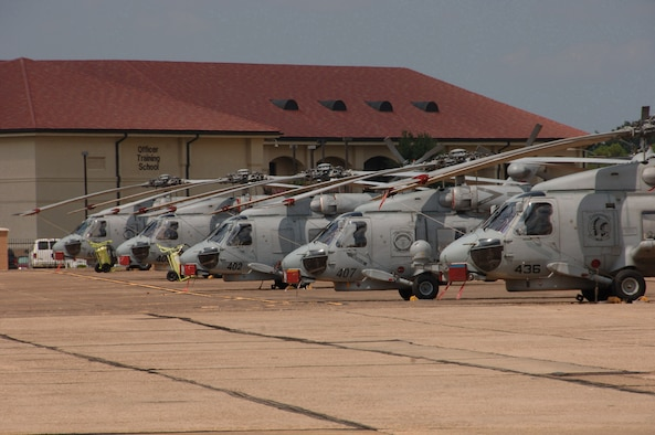 SH-60B Seahawks line up on the Maxwell Air Force Base flightline Aug. 20. Based at Naval Station Mayport in Jacksonville, Fla., nearly three dozen Seahawks and 157 personnel flew to Maxwell for shelter from Tropical Storm Fay. (Air Force photo by Donna Burnett)