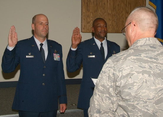 National Guard Bureau's Colonel Jeff Lewis administers the oath to newly promoted Colonels Michael Howard (right) and Gary McCue at the 179th Airlift Wing, Mansfield Ohio. Col Michael Howard is the first black Colonel at this Air National Guard base.  (U.S. Air Force photo by Technical Sgt. Lisa Haun) (Released)