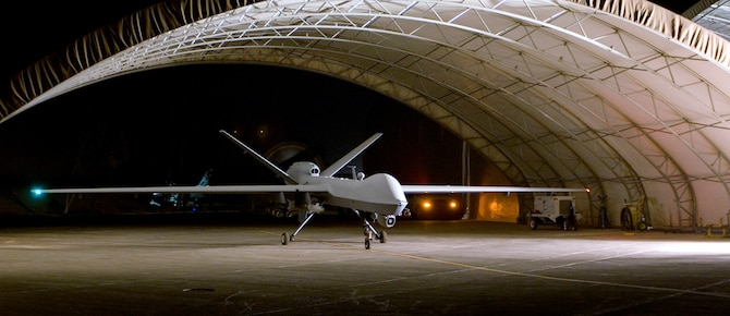 An MQ-9 Reaper remotely piloted aircraft prepares to taxi out of a hangar Aug. 8 at Joint Base Balad, Iraq. A Reaper employed a 500-pound GBU-12 laser-guided bomb against anti-Iraqi forces Aug. 16, marking the Reaper's first weapons engagement since it began flying combat sorties over Iraq July 18. (U.S. Air Force photo/Tech. Sgt. Erik Gudmundson)