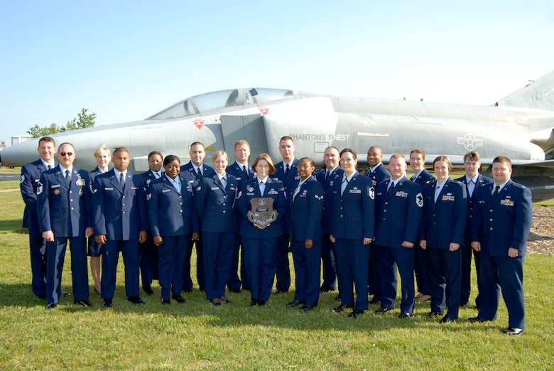 Members of the 123rd Mission Support Flight pose with their award from the NGB. (Tech. Sgt. Dennis Flora/KyANG)