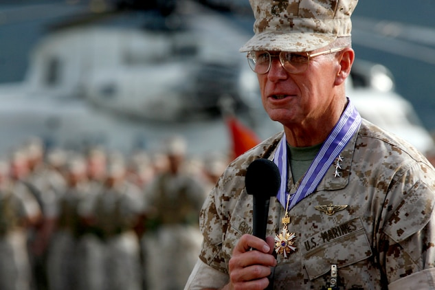 Lt. Gen. John F. Goodman, commander, U.S. Marine Corps Forces, Pacific, speaks about his 41 years of service during his change of command and retirement ceremony on the flightline here Aug. 22.