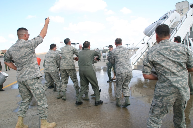 Brig. Gen. Lori Robinson, commander, 552 Air Control Wing, turned the fire hose on the hundreds of 552nd ACW Airmen, who congregated to celebrate General Robinson's final flight on the E-3 as her role as the commander of the 552 ACW comes to an end. (Photo Courtesy of 2nd Lt. Kinder Blacke)