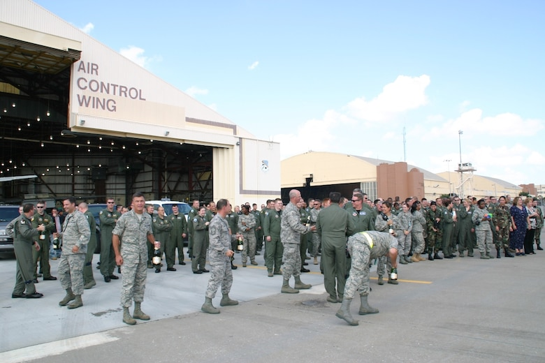 Hundreds of Airmen from the 552nd Air Control Wing and other units on base wait in anticipation for the wing commander's fini flight to arrive.