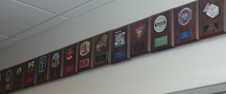 Plaques featuring the patches of former Specialized Undergraduate Pilot Training classes line the hallways of the 50th Flying Training Squadron. The 50th FTS flies the T-38C Talon in phase two of pilot training. (U.S. Air Force photo by Senior Airman Danielle Hill)