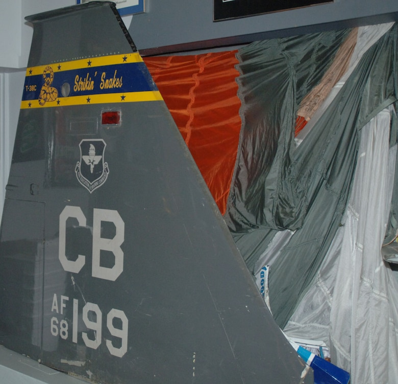 After ejecting safely from a low-level incident last year, the tailfin of the aircraft that Maj. Bill Lester was flying is on display in the 50th FTS heritage room. (U.S. Air Force photo by Senior Airman Danielle Hill)