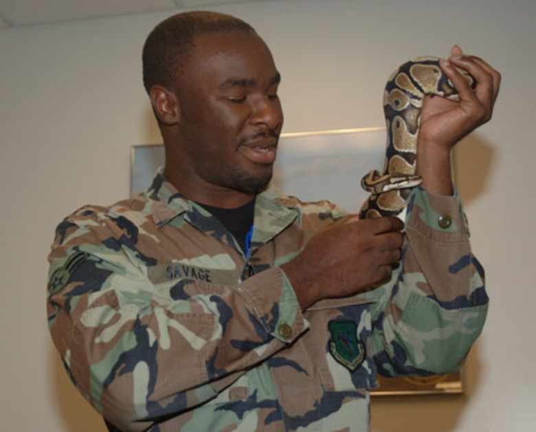 "Airman 1st Class Antonio Savage holds the squadron mascot of the 50th Flying Training Squadron ""Striking Snakes."" (U.S. Air Force photo by Senior Airman Danielle Hill)"
