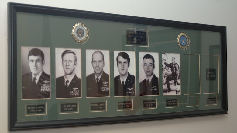 This display is dedicated to the POW's and MIA's of the 50th Flying Training Squadron. These individuals include Lt. Col. Gene Smith and Capt. George Lockhart. (U.S. Air Force photo by Senior Airman Danielle Hill)