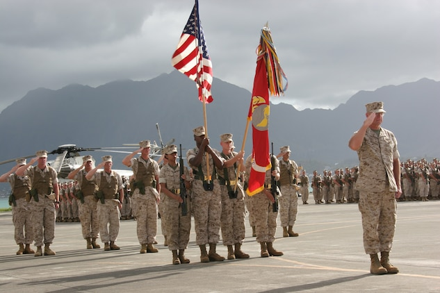 Lt. Gen. John F. Goodman, commander, U.S. Marine Corps Forces, Pacific, salutes Gen. James T. Conway, Commandant of the Marine Corps, during a change of command and retirement ceremony on the flightline here Aug. 22.  Goodman relinquished command of MarForPac and retired after 41 years of military service.