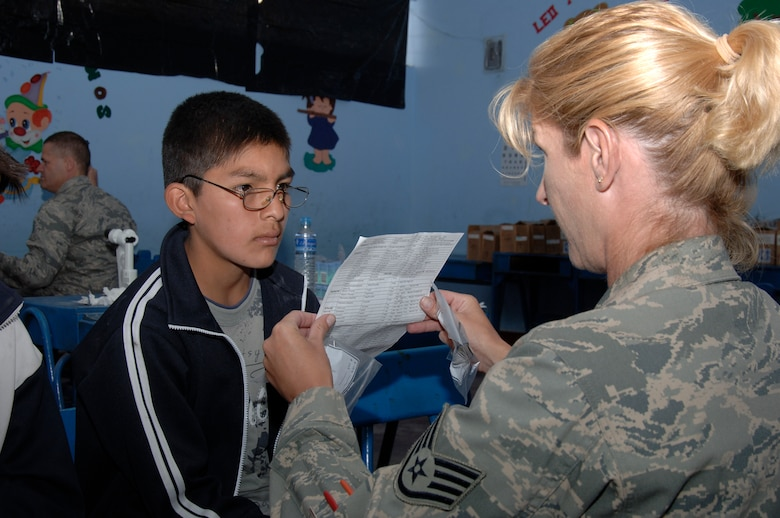 Staff Sgt. Paula Wiesmann, from the 433rd Medical Group at Lackland AFB, Texas, helps a boy test his new glasses during a medical mission in Carmen Alto, Peru, Aug. 5.  A team of 19 medical professionals deployed to Ayacucho, Peru, to support three medical exercises for New Horizons - Peru 2008, a U.S. and Peruvian humanitarian effort to bring relief to underpriviliged Peruvians. (U.S. Air Force photo/1st Lt. Mary Pekas)