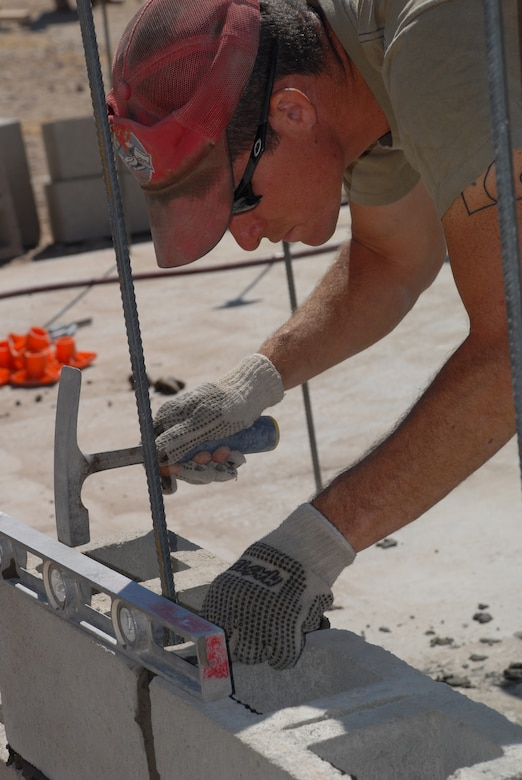 Senior Airman Russell Smith, a member of the 820th RED HORSE Squadron at Nellis Air Force Base, Nev., hammers a block in place at the construction site of a medical clinic in San Cristobal, Peru, July 1.  RED HORSE engineers are deployed to Ayacucho, Peru in support of New Horizons - Peru 2008, a U.S. and Peru humanitarian effort to bring relief to underpriviliged Peruvians. (U.S. Air Force photo/Airman 1st Class Tracie Forte)