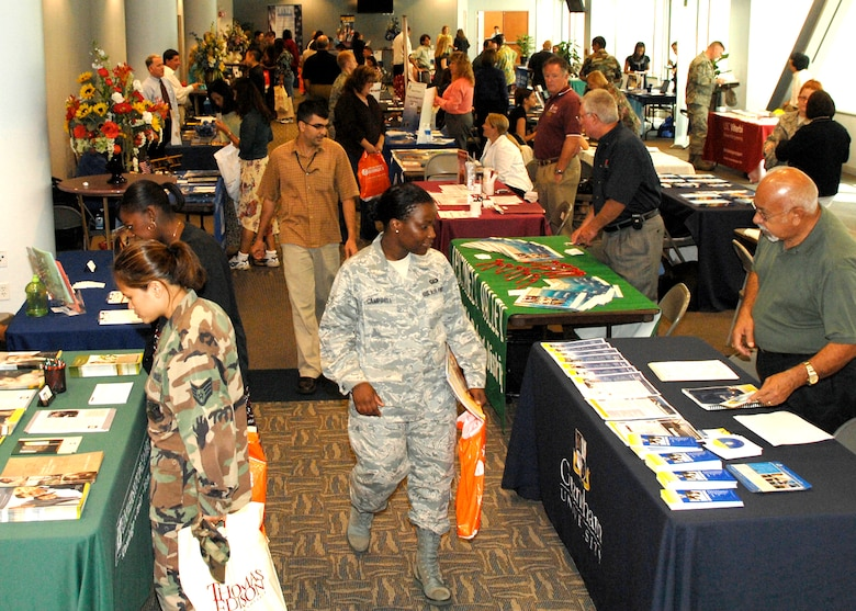 The annual Education Fair, sponsored by the Education Office, hosted 38 educational institutions and was attended by more than 200 base personnel at the Gordon Conference Center, Aug. 19. The fair gave attendees the opportunity to meet representatives from various schools including on-base campus and online education. (Photo by Stephen Schester)