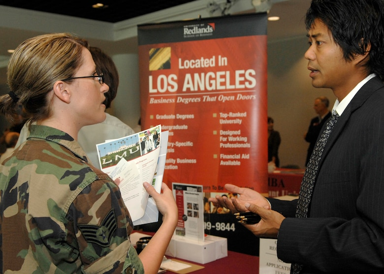 Staff Sgt. Jennifer Dodd, 61st Communications Squadron, talks to an University of Redlands representative at the annual Education Fair held at the Gordon Conference Center, Aug. 19. (Photo by Stephen Schester)