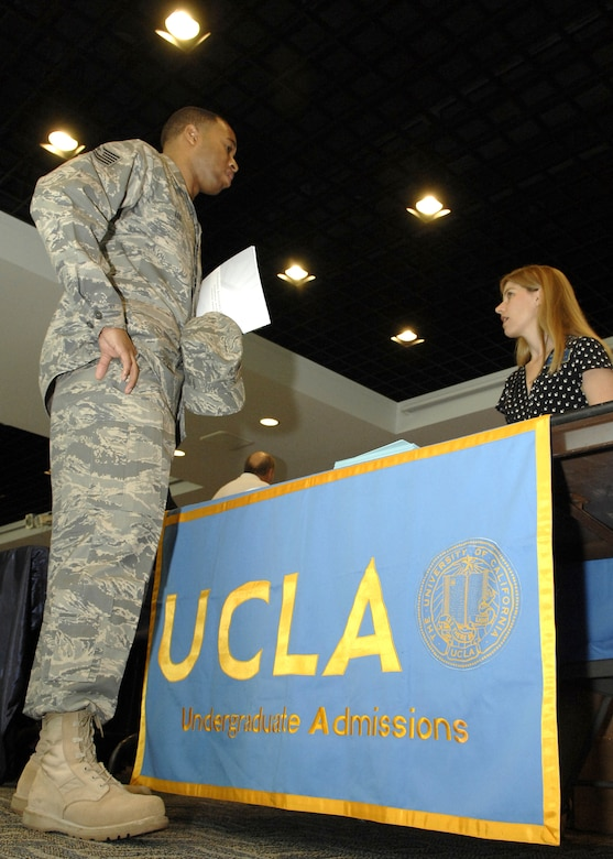 Tech. Sgt. Byron Lee, Space and Missile Systems Center Command Section, talks to a representative from University of California, Los Angeles, at the annual Education Fair held at the Gordon Conference Center, Aug. 19. (Photo by Stephen Schester)