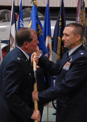 Col. David Culbertson, 926th Group, passes on some personal words before handing over the guidon to new commander, Lt. Col. John Breazeale at the 84th Test and Evaluation Squadron activation ceremony Aug 26 at the Air Armament Museum.   The 84 TES is the newest and only reserve squadron in the 53d Wing.  The squadron members fill regular Air Force positions within the wing's various units but report back to their reserve unit.  The squadron is scheduled to have 18 members by year's end and 56 by 2012.  Photo by Staff Sgt. Samuel King Jr.