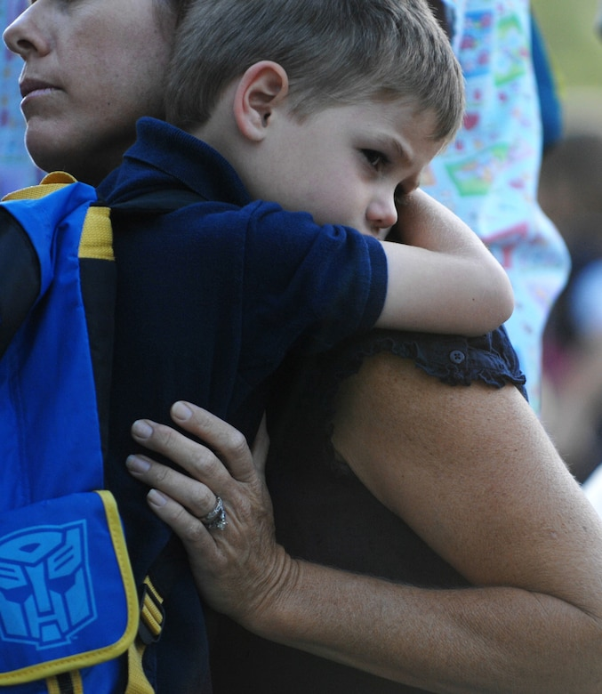 MOUNTAIN HOME AIR FORCE BASE, Idaho - Marcus Breed hugs his mother before going inside to start his first day of kindergarten class Aug. 25. Today is the first day of school for the children attending the Base Primary School at Mountain Home Air Force Base. (U.S. Air Force photo Airman 1st Class Stephany Miller)