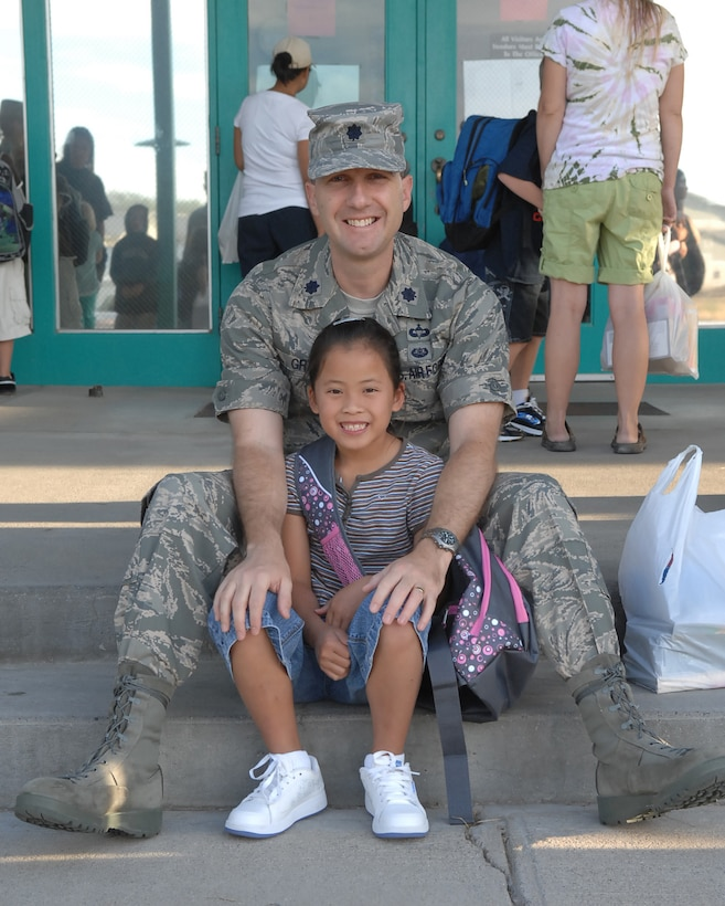 MOUNTAIN HOME AIR FORCE BASE, Idaho - Lt. Col. Matthew Grant, 366th Fighter Wing legal office, sits on the steps with his daughter outside of the Base Primary School Aug. 25. Today is the first day of school for the 2008-2009 school year on Mountain Home Air Force Base. (U.S. Air Force photo/ Airman Deborah Young)