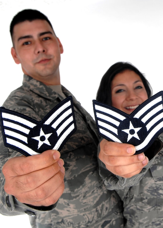 Senior Airmen John and Sonia Vega show off their new staff sergeant stripes after the promotion results were released Aug. 20.  The Senior Airmen Vegas were high school sweet hearts whohave been married for more than four years and have two sons. (U.S. Air Force photo by Airman 1st Class Joanna M. Kresge)