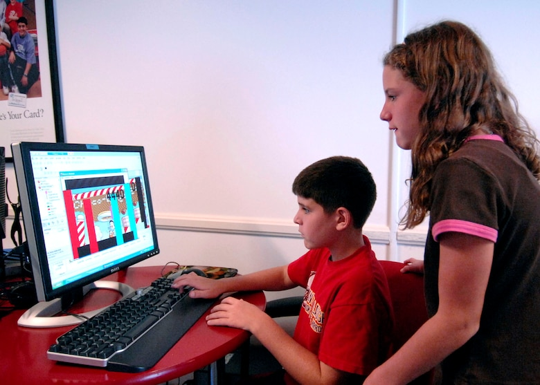 Robert-Michael and his sister Ryann Midkiff are learning to manipulate and construct a computer game as part of the Youth Summer Camp, Technology Week at Fort Mac Arthur Youth Center Aug. 18-22.  Their dad is Master Sgt. Stephen Midkiff, 61st Civil Engineering Logistics Squadron. (Photo by Lou Hernandez)