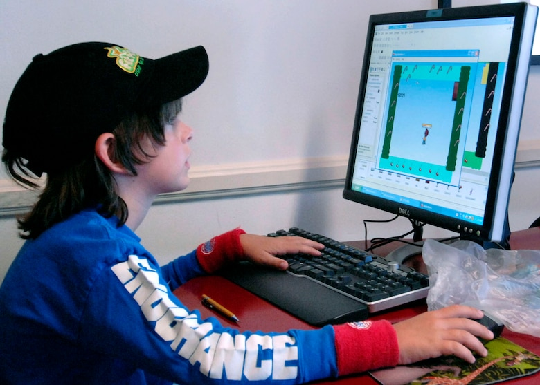 Sean Leppellere, son of Lt. Col. Anthony Leppelle, Space and Missile Systems Center Contracting, is learning to manipulate and construct a computer game as part of the Youth Summer Camp, Technology Week at Fort Mac  Arthur Youth Center, Aug.18-22.  (Photo by Lou Hernandez)