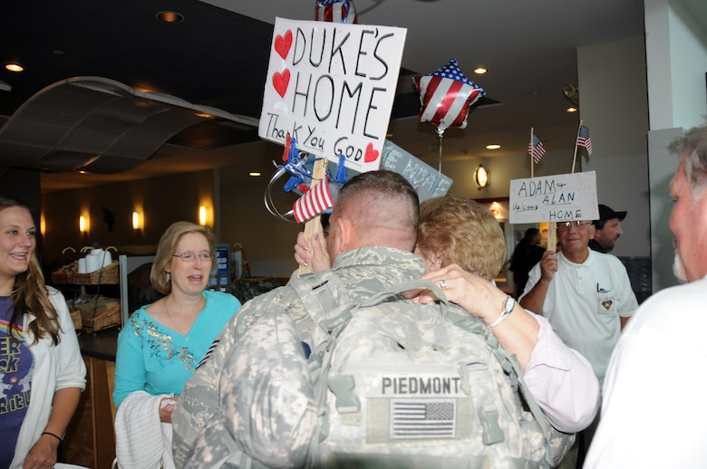 Tech Sgt. Adam ?Duke? Piedmont is greeted by his friends and family.  (U.S. Air Force photo/Senior Airman Peter Dean)