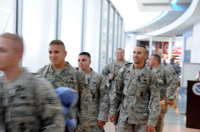 Security forces new mission, to reunite with their families. (U.S. Air Force photo/Senior Airman Peter Dean)
