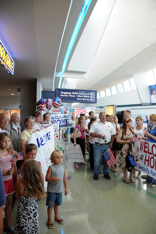 More than 100 friends, families and loved ones eagerly await the return of the 107th AW Security Force Squadron.  (U.S. Air Force photo/Senior Airman Peter Dean)