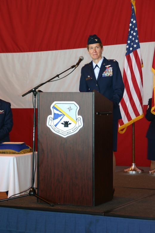Col. Patricia Hoffman addresses her Airmen for the first time as the new 552nd Air Control Wing Commander. Photo Courtesy of 2nd Lt. Kinder Blacke.