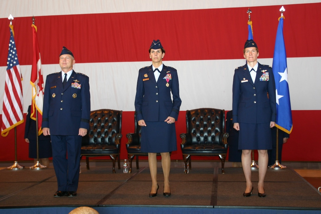 The official party stands at attention during the chang of command ceremony. From left to right: Lt. Gen. Robert Elder, Commander, 8th Air Force; Brig. Gen. Lori Robinson, outgoing 552 Air Control Wing Commander; and Col. Patricia Hoffman, incoming 552 Air Control Wing Commander.