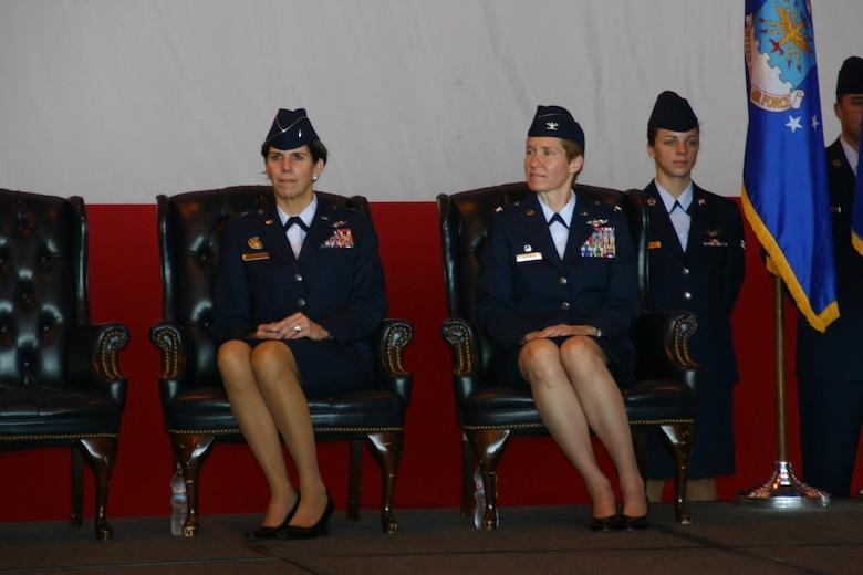 The outgoing and incoming commanders of the 552nd Air Control Wing sit side by side during the change of command ceremony. Photo Courtesy of 2nd Lt. Kinder Blacke.