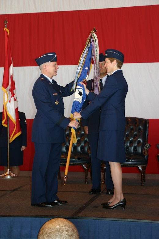Lt. Gen. Robert Elder, Commander, 8th Air Force, passes the flag, and command of the 552nd Air Control Wing to Col. Patricia Hoffman in a change of command ceremony August 27th. Photo Courtesy of 2nd Lt. Kinder Blacke.