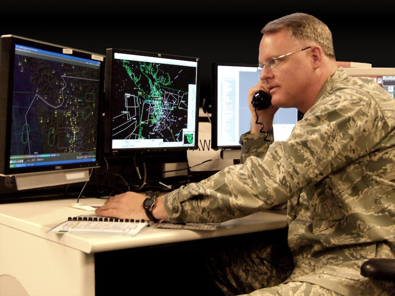 Lt. Col. William Krueger, a mission crew commander at WADS, works a call similar to he one he received when helping Harlon Hain through the clouds Aug. 12.  Krueger and his crew used raw radar data to fix Hain's position and assisted FAA in vectoring an EA-6B Prowler to him.  (U.S. Air Force photo by Vivian Wilson)