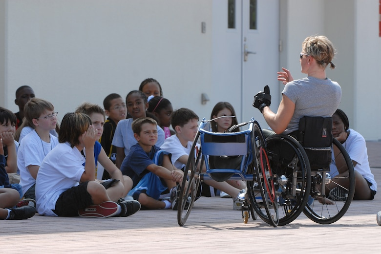 U.S. Paralympian Cheri Blauwet answers questions from a group of middle school students  at Kadena Air Base, Japan Aug. 28. More than 100 athletes and support staff from the U.S. Paralympics track and field and swim teams arrived at Kadena Aug. 24 to live and train for the next ten days in preparation for the 2008 Paralympic Games held in Beijing, China Sept. 6. (U.S. Air Force photo/Airman 1st Class Chad Warren)