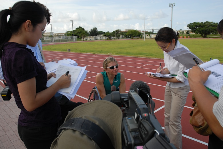 U.S. Paralympian Cheri Blauwet answers questions from local Okinawan reporters at Kadena Air Base, Japan on Aug. 27. More than 100 athletes and support staff from the U.S. Paralympic track and field and swim teams arrived at Kadena Aug. 24 to live and train for the next ten days in preparation for the 2008 Paralympic Games held in Beijing, China Sept. 6-17. (U.S. Air Force photo/Airman 1st Class Chad Warren)