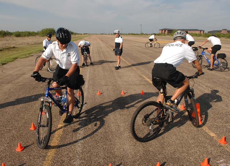 Members of the 17 SFS line up during a basic bicycle skills training course Aug. 22 on Goodfellow. Members of the 17 SFS took the course to augment Goodfellow's security patrols with bikes. (U.S. Air Force photo by Staff Sgt. John Barton)