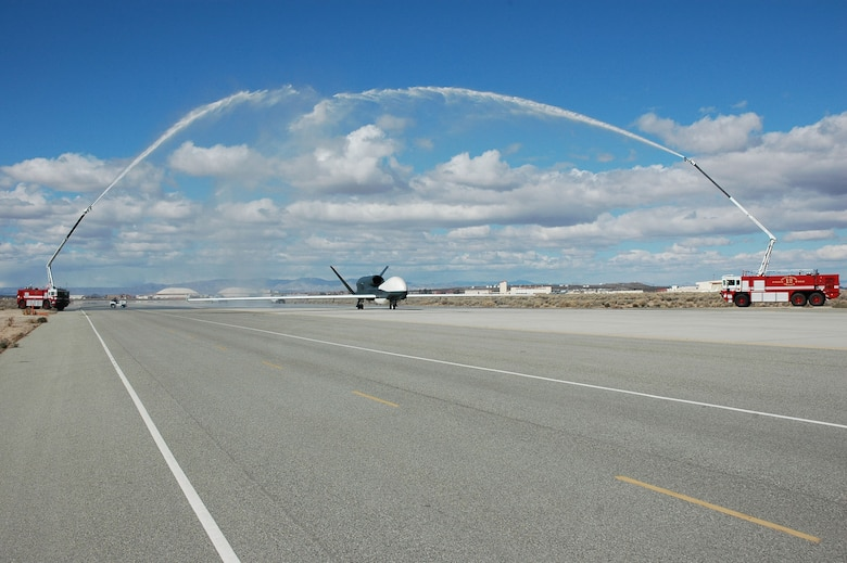The return of AV-3 to Edwards Air Force Base, Calif., was celebrated with fire trucks shooting streams of water over the aircraft. (Photo courtesy of Mo Pourmand)