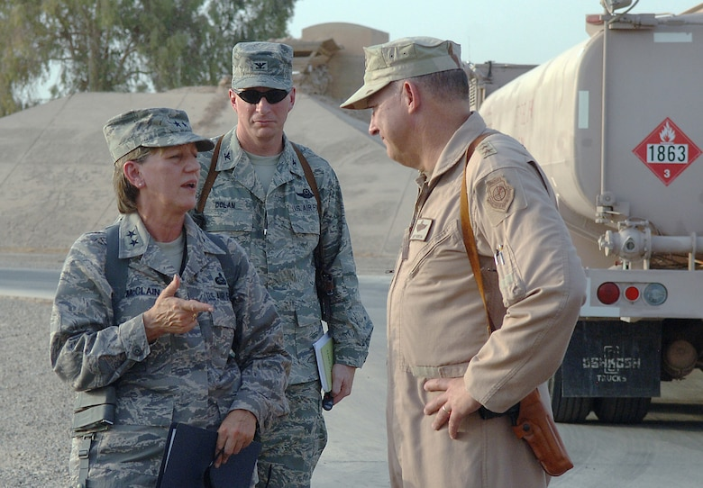 JOINT BASE BALAD, Iraq -- Maj. Gen. K. C. McClain (left) speaks with Lt. Gen. Gary North (right) about their tour of the 332nd Expeditionary Logistics Readiness Squadron's Petroleum, Oil and Lubricants Management Flight here Aug. 27. McClain accompanied North on a tour of several locations here and throughout the U.S. Central Command area of responsibility. This is McClain's first visit to the Middle East since assuming command of the Air Force Personnel Center in January. North is the commander of U.S. Air Forces Central and the Combined Forces Air Component Commander. Also pictured is Col. John Dolan, 332nd Air Expeditionary Wing vice commander. (U.S. Air Force photo/Tech. Sgt. Richard Lisum)